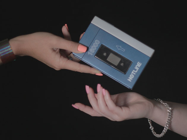 Someone handing someone a power bank, styled to look like a cassette player.