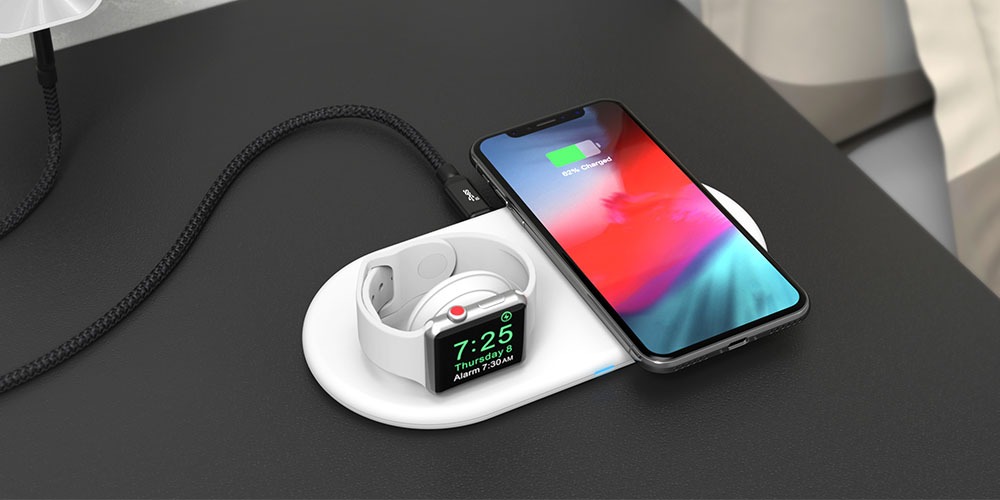 A charging pad with a phone and smart watch on it