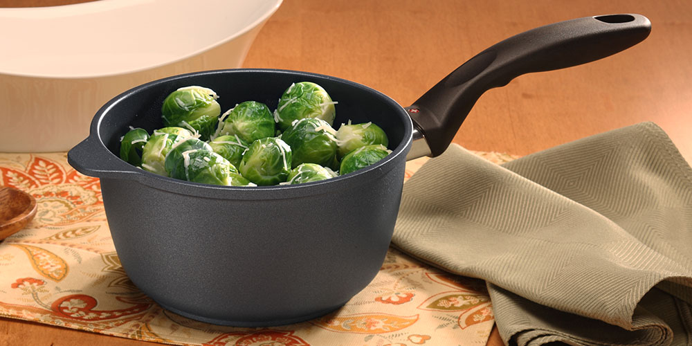 A sauce pan with Brussels sprouts inside