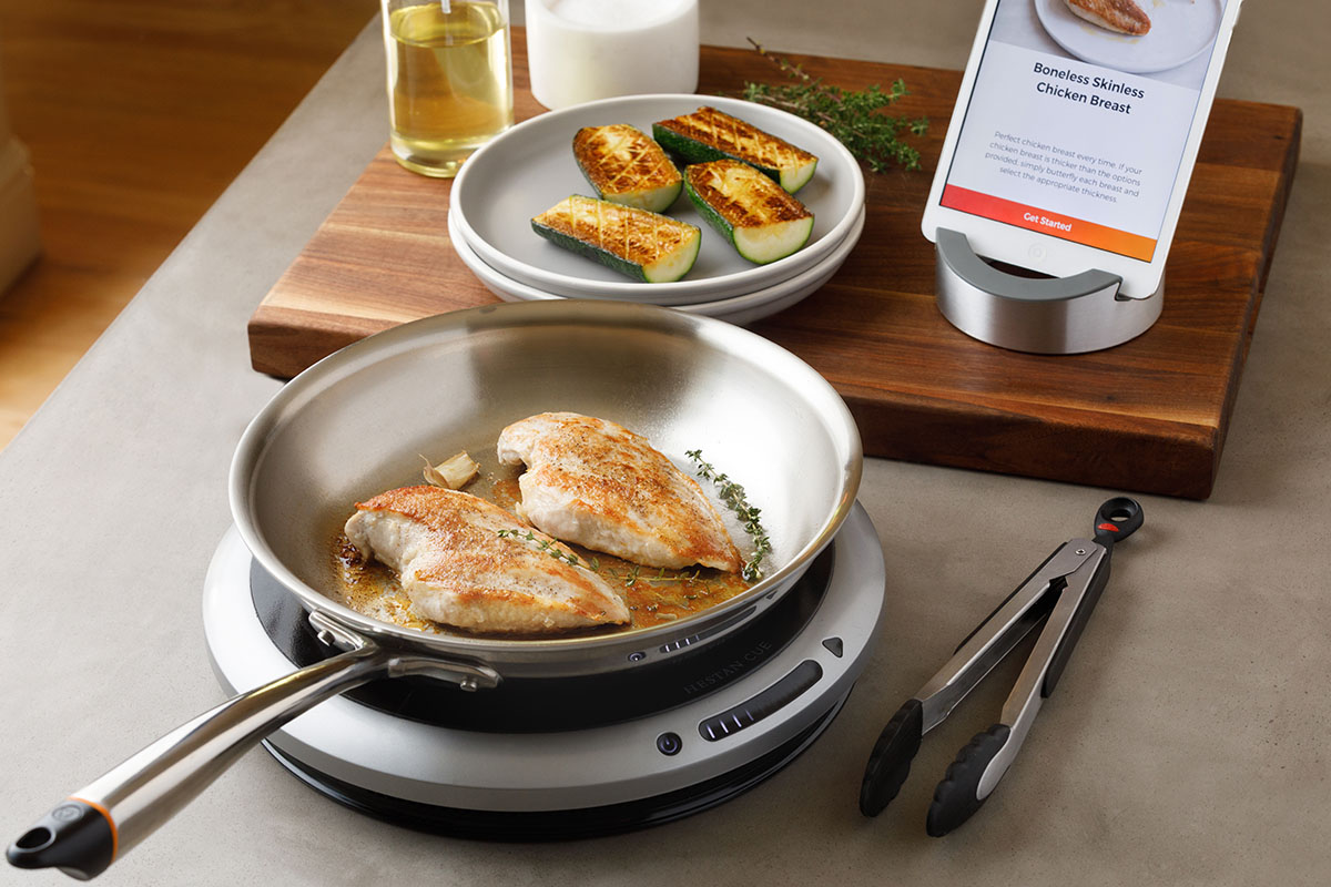 The Hestan Cue smart cooking system, cooking chicken and zucchini
