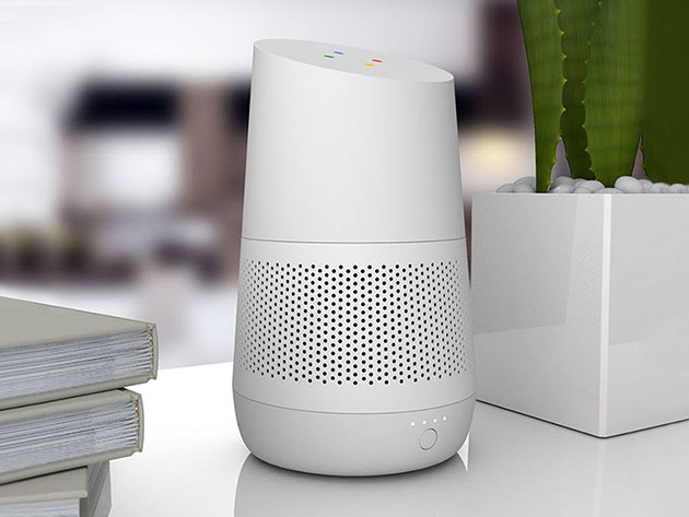 A white Google Home device on a desk.