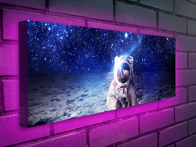 Add a Surreal & Ethereal Glow to Your Room with This Cosmonaut LED Backlit Wall Art