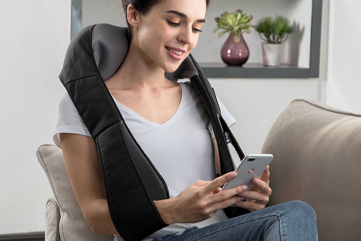 A person wearing a massage vest