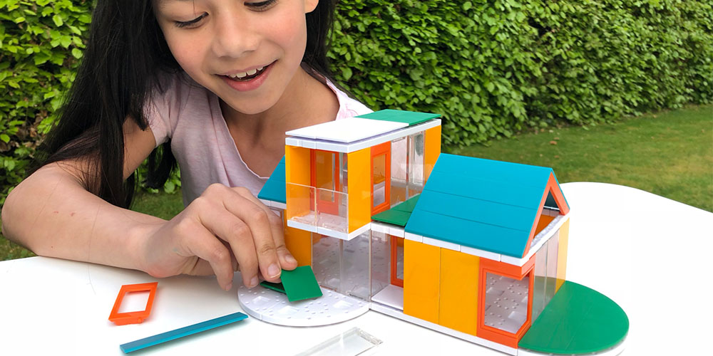 A child using an architect model kit