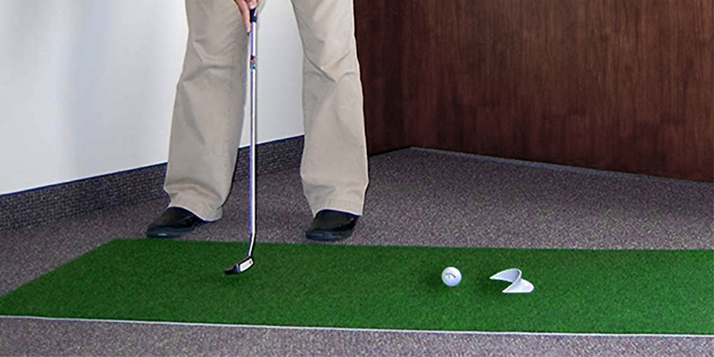 A person using a putting mat.